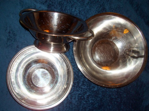Stainless steel bowls and colander for pressing small amounts of pomace.